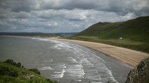 Wales plans to end its five-mile restriction on travel next month and allow holidaymakers to return a week later, First Minister Mark Drakeford has said (Yui Mok/PA)