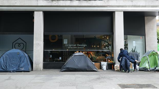 Homeless people's tents erected outside a furniture store in Tottenham Court Road, London (Yui Mok/PA)