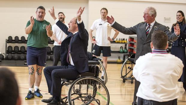 The Duke of Cambridge gets the ball through the hoop while playing wheelchair basket ball during a visit to the Defence Medical Rehabilitation Centre Stanford Hall, Stanford on Soar, Loughborough, where he met with patients and staff and had a tour of the gym and prosthetics workshop.(Richard Pohle/The Times/PA)