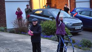 People in Southam in Warwickshire clapping to salute local heroes (Jacob King/PA)
