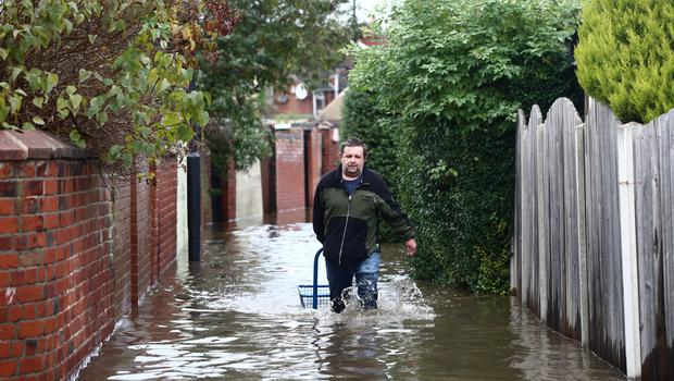 A man walks through flood water in Doncaster (Danny Lawson/PA)