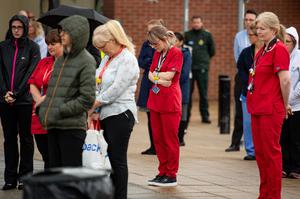 Staff members fell silent outside the Royal Derby Hospital (Jacob King/PA)