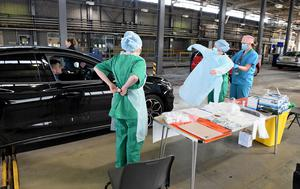 Health staff put on their PPE masks, gloves and gowns in Belfast (Justin Kernoghan/PA)