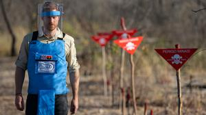 The Duke of Sussex walks through a partially cleared minefield in Angola during a visit last year to see the work of the Halo Trust (Dominic Lipinski/PA)