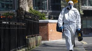 A man wearing a protective face mask and clothing in Westminster, London (Victoria Jones/PA)