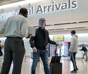 Passengers arrive at Terminal 2 at Heathrow Airport in London yesterday