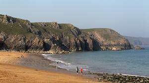 Tourists are being asked to stay away from attractions such as Barrafundle Beach in Pembrokeshire (David Davies/PA)