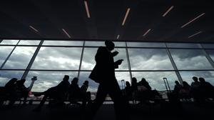 Passengers travelling through Manchester, Stansted and East Midlands airports are being ordered to cover their faces and wear gloves (Yui Mok/PA)