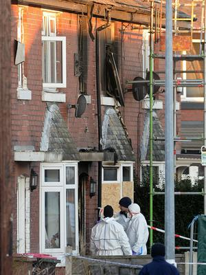 Forensic officers at the scene of the fire on Jackson Street in Worsley (Peter Byrne/PA)
