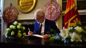 Labour leader Jeremy Corbyn signs a book of condolence at the Sri Lankan High Commission in London (Victoria Jones/PA)