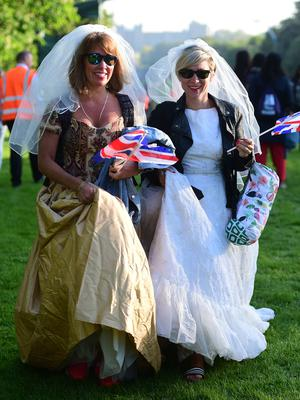 Royal brides: Fans dress for the occasion in Windsor (David Mirzoeff/PA)