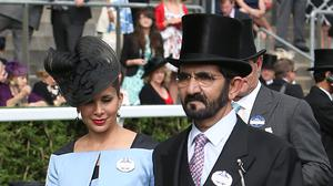 Sheikh Mohammed bin Rashid Al Maktoum and his wife Princess Haya (Steve Parsons/PA)
