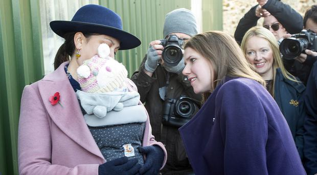 Jo Swinson meets Daphne Grint, aged five months, and her mother Rebecca Bell during a visit to Crafty Maltsters at Demperston Farm, Auctermuchty (Lesley Martin/PA)