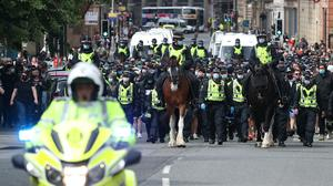 Protesters are escorted by police from George Square in Glasgow city centre (Andrew Milligan/PA)