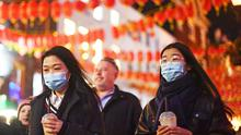 People wearing masks in China Town, London, as two people in the UK have tested positive for Coronavirus (Victoria Jones/PA)
