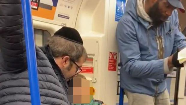 A family being harassed and targeted with antisemitic abuse by a man on the Tube (Chris Atkins/PA)
