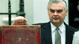 Norman Lamont holds up his briefcase before delivering the Budget in March 1993 – the biggest tax-rising Budget since 1970 (David Giles/PA)