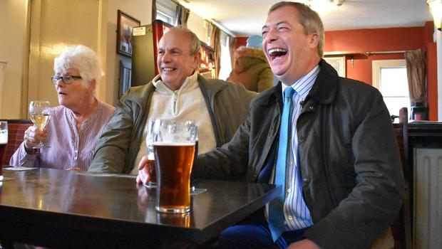 Brexit Party leader Nigel Farage shares a joke with supporters (Matthew Cooper/PA)