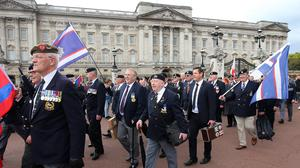 Supporters march past Buckingham Palace (Gareth Fuller/PA)