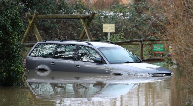 A submerged car in Yalding, Kent, after the area flooded following heavy rain (Gareth Fuller/PA)