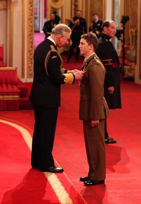 Mr Cutterham was presented with the Conspicuous Gallantry Cross by Prince Charles during an investiture ceremony at Buckingham Palace in 2012 (Lewis Whyld/PA)