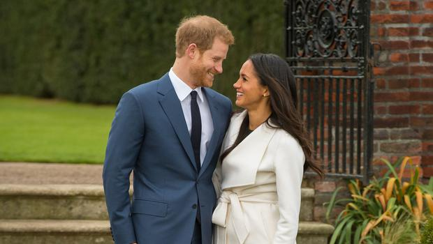 Prince Harry and Meghan Markle in the Sunken Garden at Kensington Palace, London, after the announcement of their engagement (Dominic Lipinksi/PA)