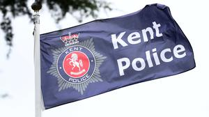 Armed police have been deployed near a shopping centre in Kent after a man was reported to be on a balcony with weapons (PA)