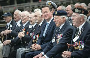 Prime Minister David Cameron joins veterans aboard the HMS Belfast for the 70th anniversary D-Day commemorations yesterday in London. HMS Belfast was one of the first ships to open fire on German positions on June 6, 1944