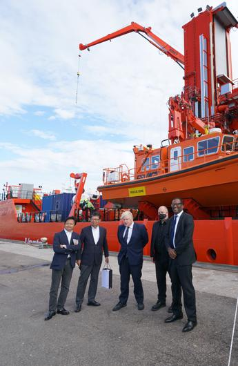 Prime Minister Boris Johnson (centre) and business minister Kwasi Kwarteng (right), meeting wind farm project investors and project delegates in Fraserburgh Harbour, Aberdeenshire (Jane Barlow/PA)