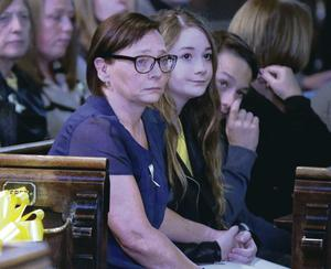 Barbara Henning, wife of murdered aid volunteer Alan Henning, sits with family members as they attend a 'service of reflection' yesterday to honour his memory