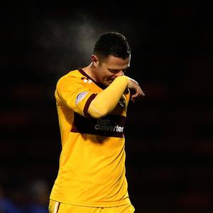 Motherwell's Michael Higdon was named PFA Scotland Player of the Year at a ceremony at the Hilton hotel on Sunday night