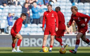 Jamie Carragher (centre) brings you witty insights into the beautiful game (Steve Welsh/PA Archive)