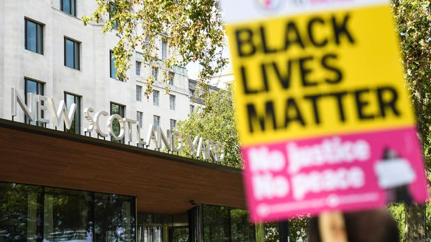 Protesters outside New Scotland Yard in London (Kirsty O'Connor/PA)