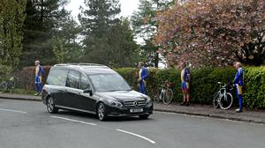 Members of Loch Lomond Road Cycling Club follow social distance guidelines as they form a guard of honour (Andrew Milligan/PA)