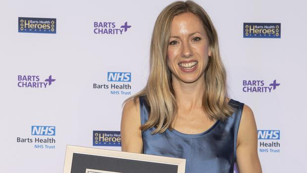 NHS Nurse Jessica Anderson receives her Guinness World Record certificate for fastest marathon run in a nursing uniform.Credit: Barts Health/ PA