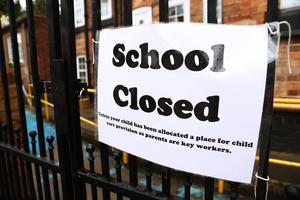 Signage outside a closed school in Nottingham (PA)