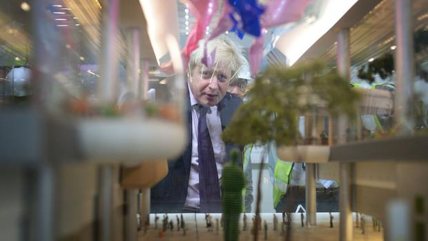 Mayor of London Boris Johnson looks at a model of the site of the new Terminal 4 at Changi Airport in Singapore