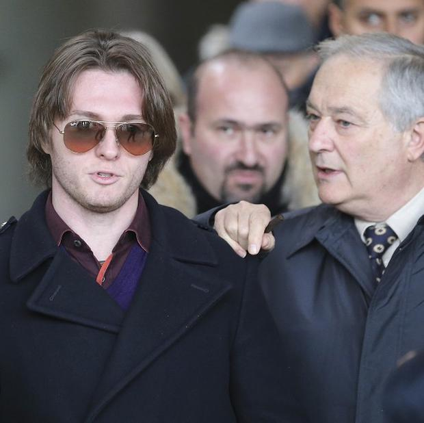 Raffaele Sollecito, pictured with his father Francesco, has had his guilty verdict over the murder of Meredith Kercher reinstated (AP)