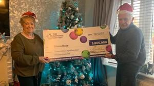 Diane Bate celebrates her £3.8m jackpot with husband Michael (National Lottery/PA)