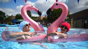 Swimmers Nicola Foster and Jessica Walker enjoy the water at Charlton Lido (Kirsty O'Connor/PA)