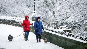 People walk dogs in Knaresborough in North Yorkshire after snow fell overnight (Danny Lawson/PA)