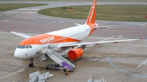 An EasyJet plane sits on the tarmac at Luton Airport in Bedfordshire (PA)