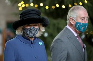 The Prince of Wales and Duchess of Cornwall both wore facemasks (Chris Jackson/PA).