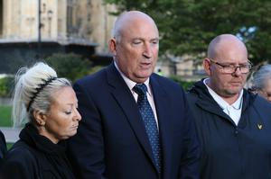 Spokesman Radd Seiger for the family of Harry Dunn, flanked by mother Charlotte Charles and father Tim Dunn (Jonathan Brady/PA)