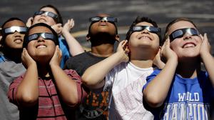 Children prepare to watch the eclipse in Missouri (Charlie Riedel/AP)