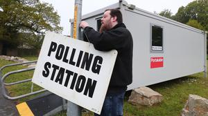 A poll clerk sets up a polling station within a Portakabin in Ashford, Kent (Gareth Fuller/PA)