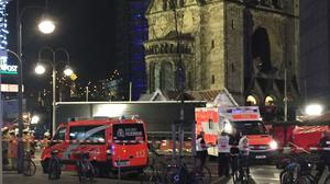 Emergency services at the scene where a truck ploughed into a crowded Christmas market outside the Kaiser Wilhelm Memorial Church in Berlin