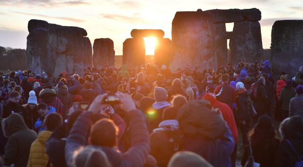 People gather at Stonehenge to mark the winter solstice (Ben Birchall/PA)