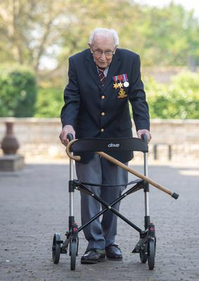 Captain Tom Moore, 99, has raised more than £13m for the NHS by walking 100 laps of his garden (Joe Giddens/PA)