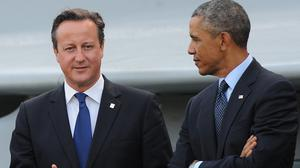 David Cameron (left) and Barack Obama are setting up a joint team to tackle cyber crime